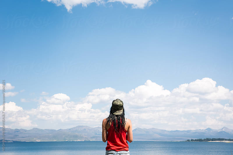 Young Woman with Blue Sky by Meg Pinsonneault for Stocksy United