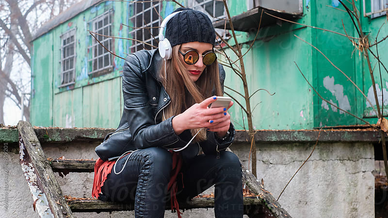 Urban Girl Using a Smartphone by Mosuno for Stocksy United