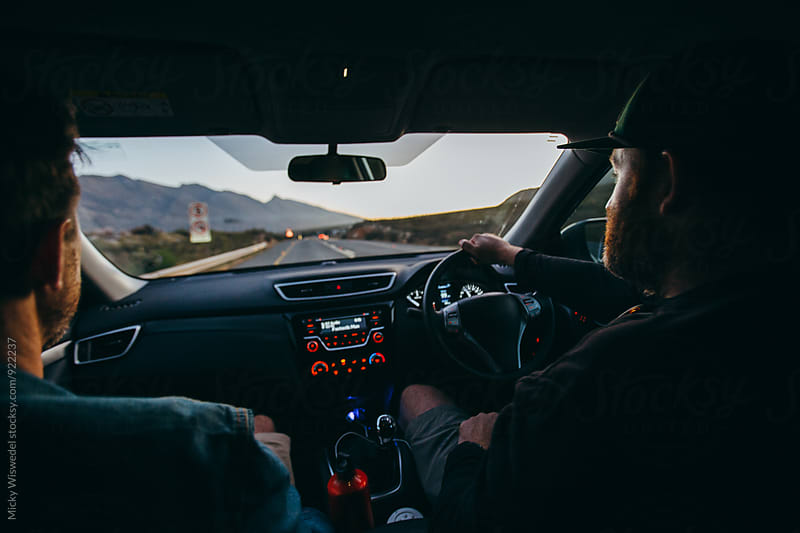 guys driving a car on a road trip by Micky Wiswedel for Stocksy United