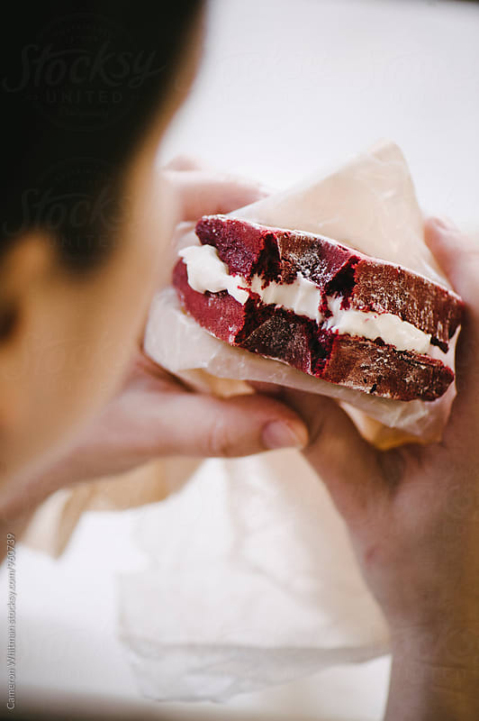 Eating a Red Velvet Cake Waffle Sandwich by Cameron Whitman for Stocksy United