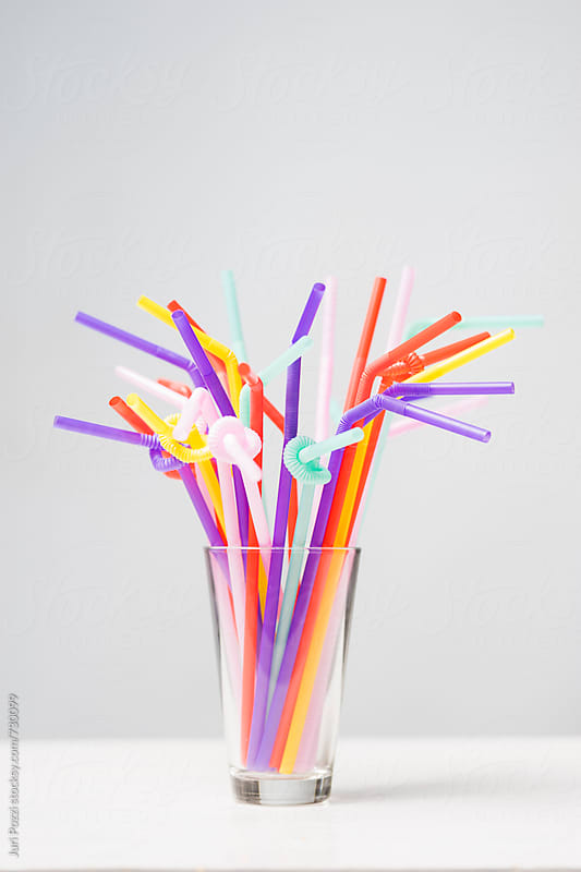 a bunch of colorful straws by Juri Pozzi for Stocksy United
