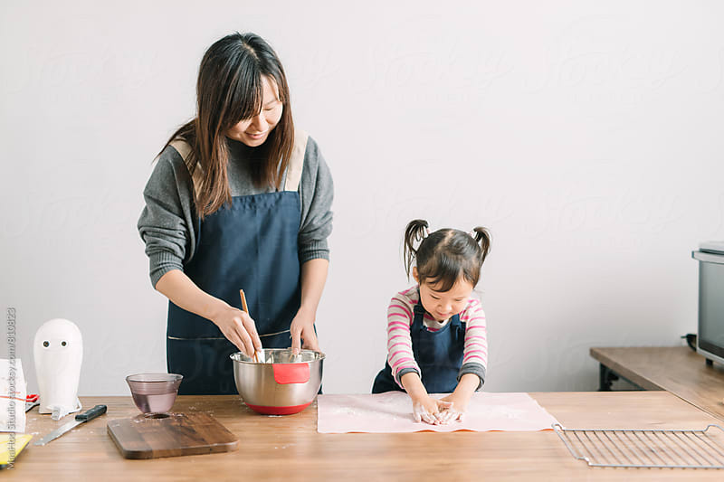Mother and toddler girl making cookies by MaaHoo Studio for Stocksy United