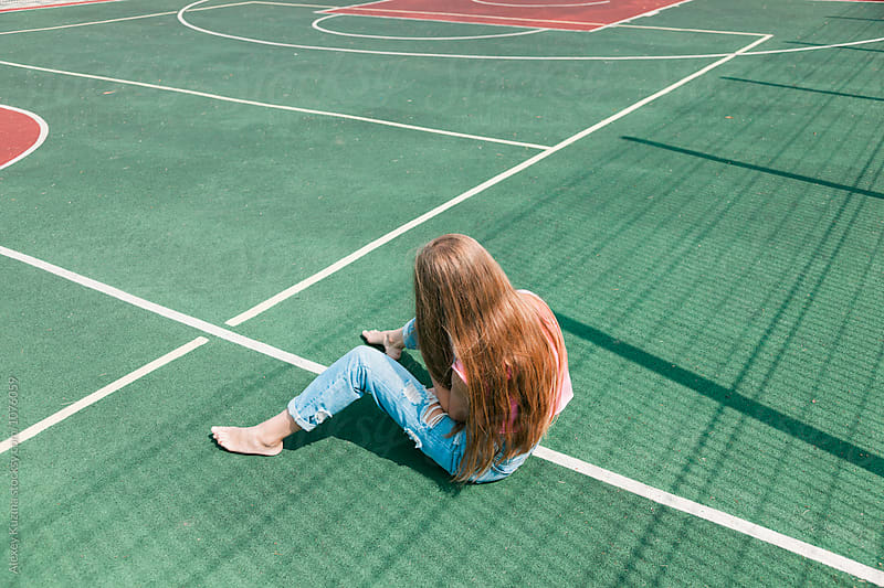 girl on the school sport field  by Vesna for Stocksy United