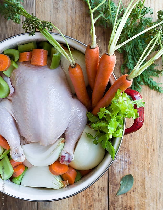 DIY Homemade chicken stock broth for wellness by Trent Lanz for Stocksy United
