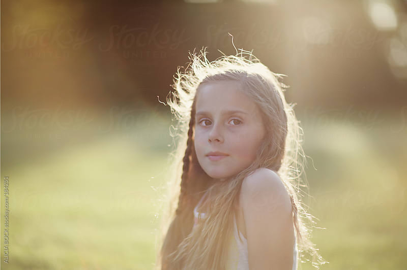 Girl Sitting In the Sun On A Summer Evening by ALICIA BOCK for Stocksy United