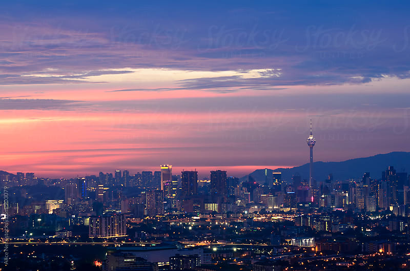Stunning view to Kuala Lumpur at the sunset by Alice Nerr for Stocksy United