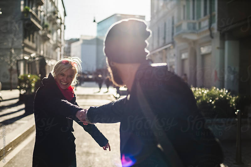 Young couple having fun together in the city by GIC for Stocksy United