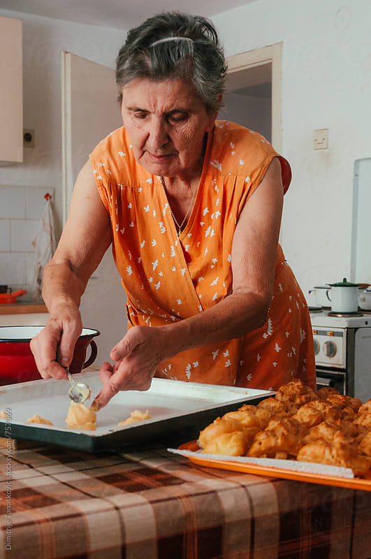 Senior woman in the kitchen by Dimitrije Tanaskovic for Stocksy United
