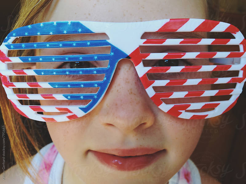 Close up of girl wearing American Flag sunglasses. by Kelsey Gerhard for Stocksy United