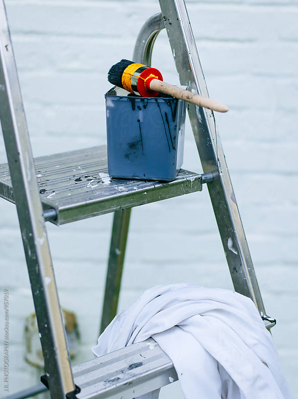 Ladder with paintbrush and paint bucket by J.R. PHOTOGRAPHY for Stocksy United