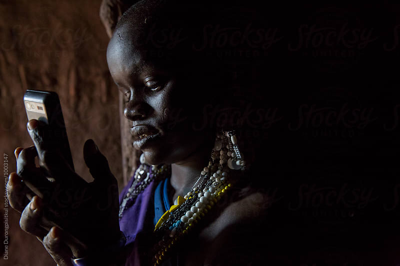 Maasai Girl with Mobile Phone by Diane Durongpisitkul for Stocksy United