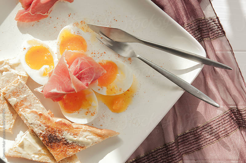 Sorano ham and eggs. by Darren Muir for Stocksy United