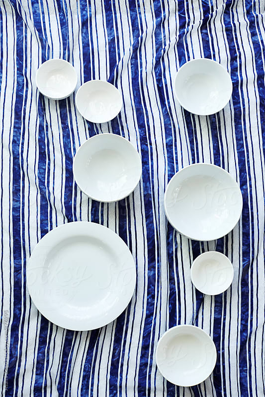 Round white plates by Asami Zenri for Stocksy United