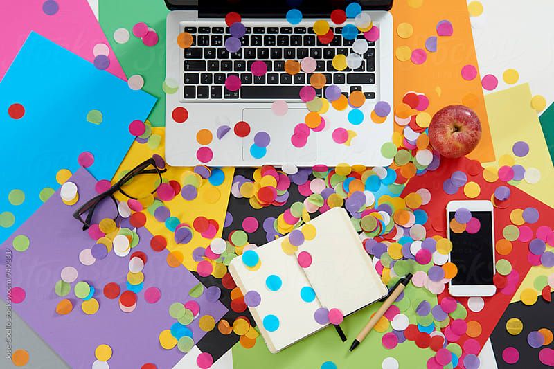 Confetti Office. by Jose Coello for Stocksy United