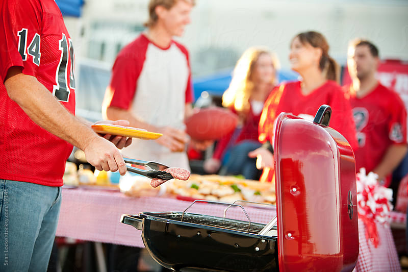 Tailgating: Grilling Food for Tailgate Party by Sean Locke for Stocksy United