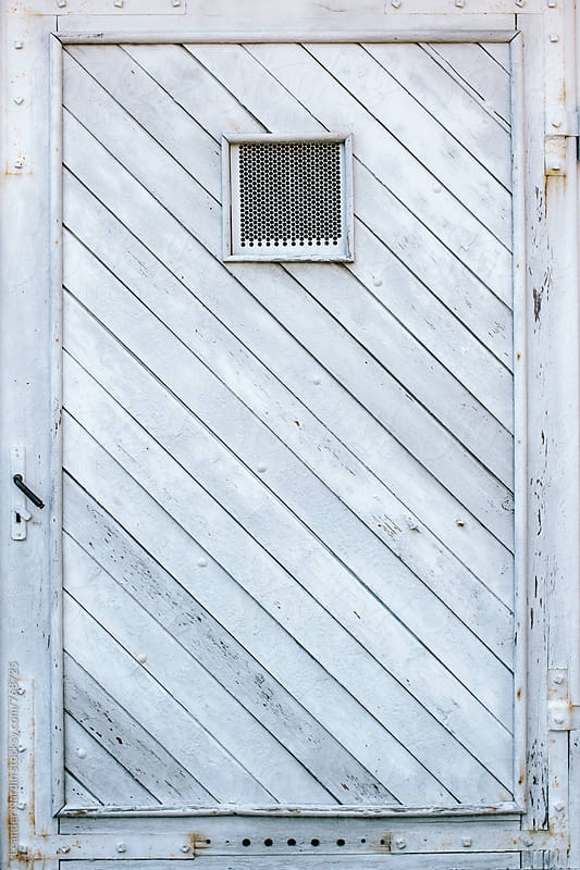 old white wooden rusty door by Leander Nardin for Stocksy United