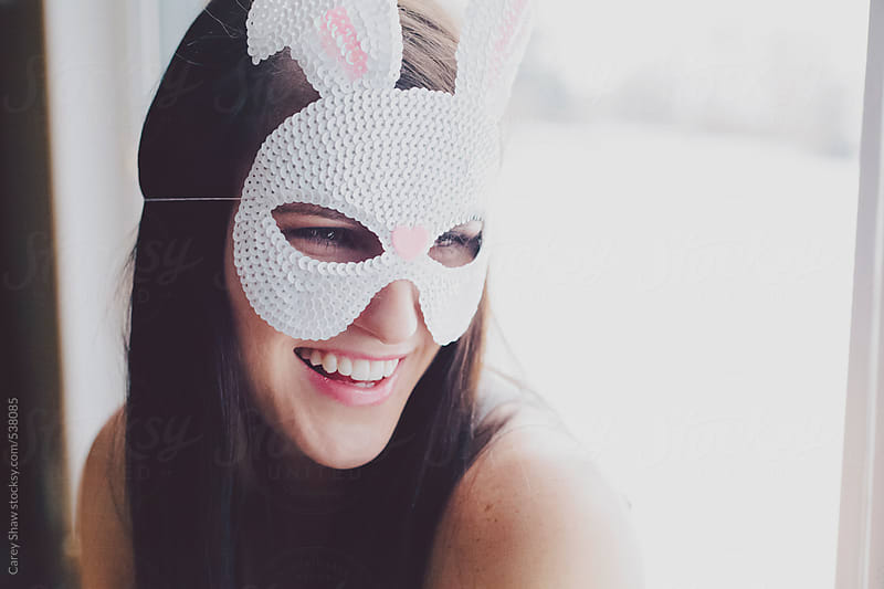 Woman wearing bunny mask by Carey Shaw for Stocksy United