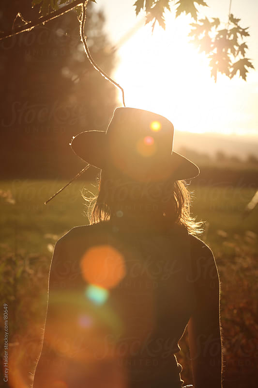A Man Looking At A Sunset On A Farm by Carey Haider for Stocksy United