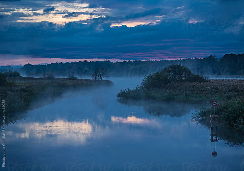 Morning mist on the river by Photographer Christian B for Stocksy United