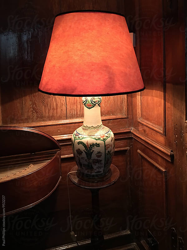 Table lamp standing in the corner of a period room. by Paul Phillips for Stocksy United