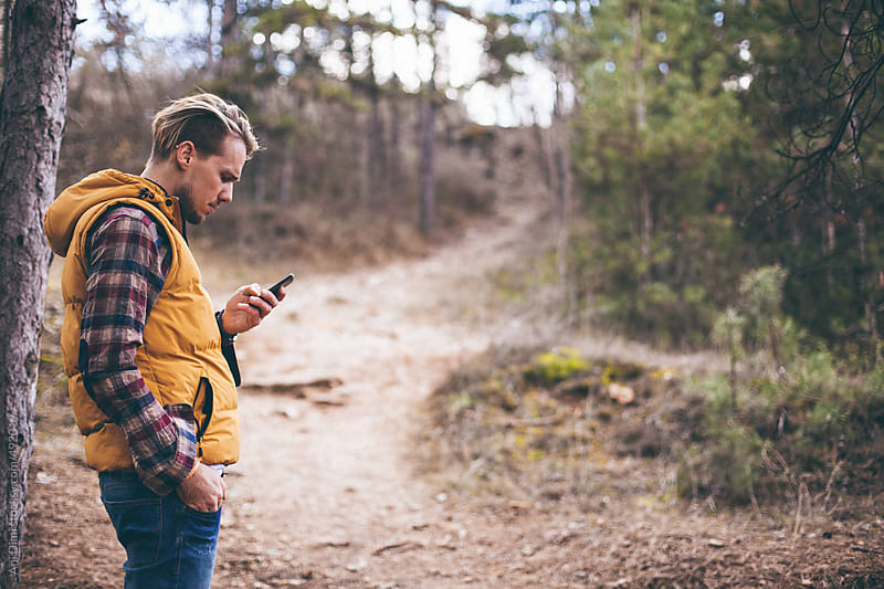 Man with smartphone by Ani Dimi for Stocksy United