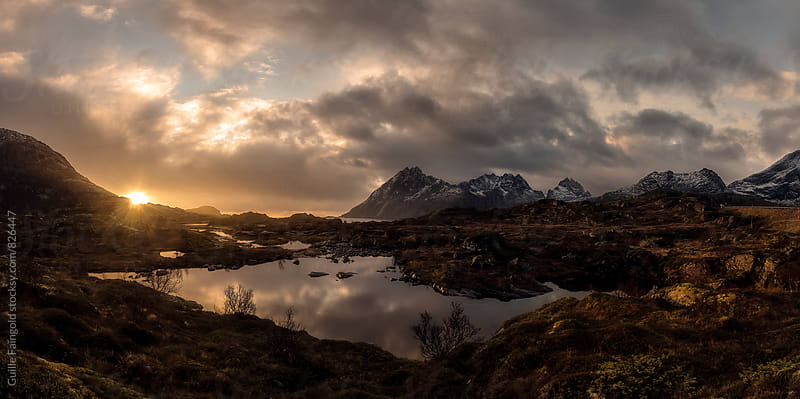 Colorful sunrise in Lofoten islands, Norway by Guille Faingold for Stocksy United