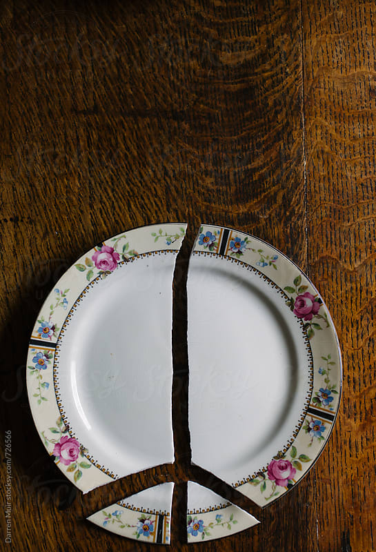 Smashed floral plate in shape of a peace sign. by Darren Muir for Stocksy United