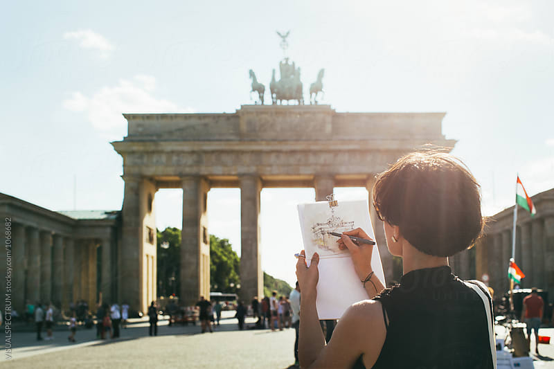 Young Female Artist Drawing Berlin's Brandenburg Gate on Sunny Day by Julien L. Balmer for Stocksy United