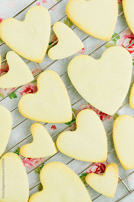 Heart shaped cookies on floral rom above by Kirsty Begg for Stocksy United