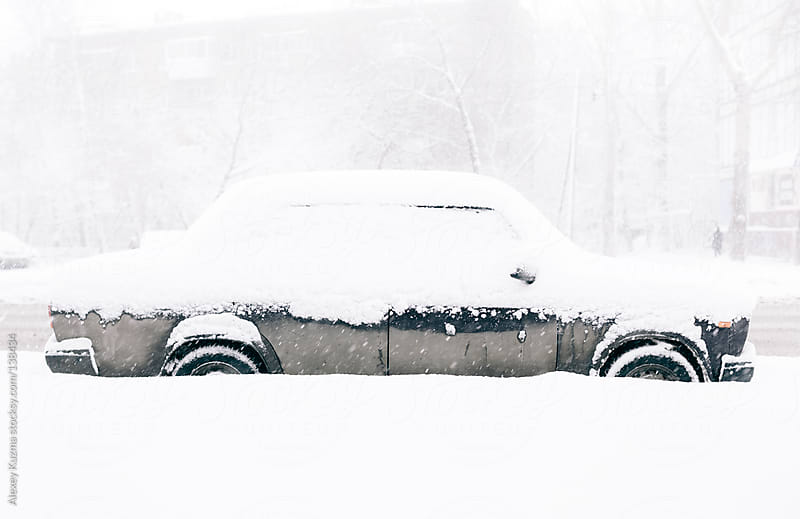 Car Covered in Snow by Alexey Kuzma for Stocksy United