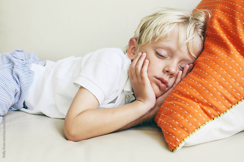 sweet, little boy sleeping by Kelly Knox for Stocksy United