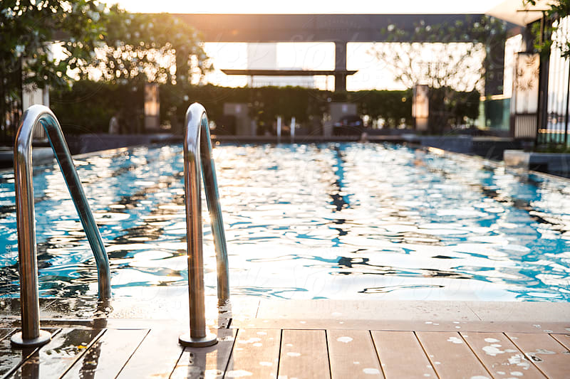Swimming pool at sunset by Jovo Jovanovic for Stocksy United