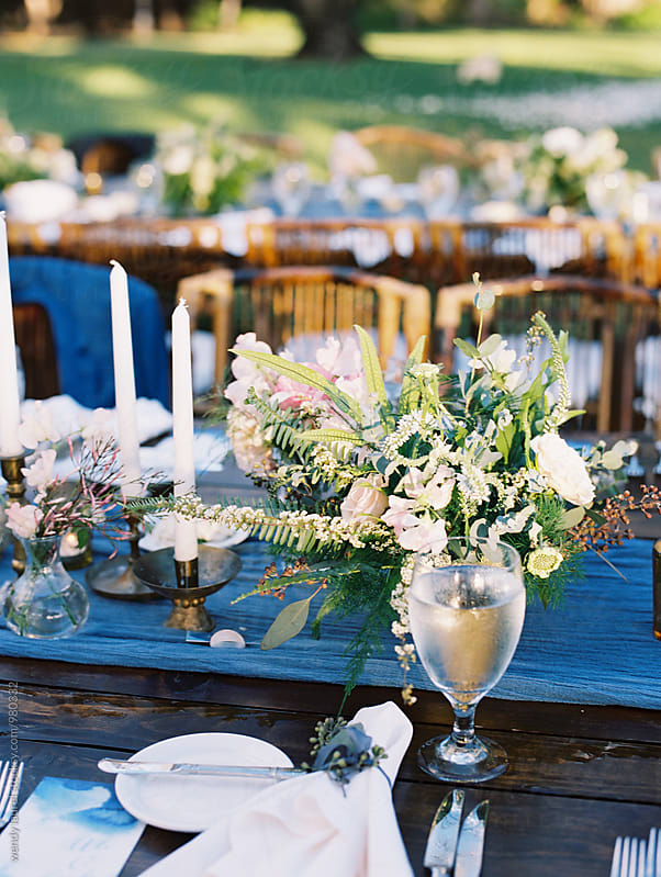 table settings with blue runner by wendy laurel for Stocksy United