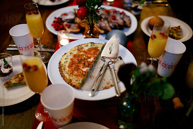 A table with a quiche set for a holiday brunch by Jennifer Brister for Stocksy United