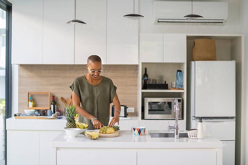 Beautiful black woman preparing healthy snacks by Jovo Jovanovic for Stocksy United