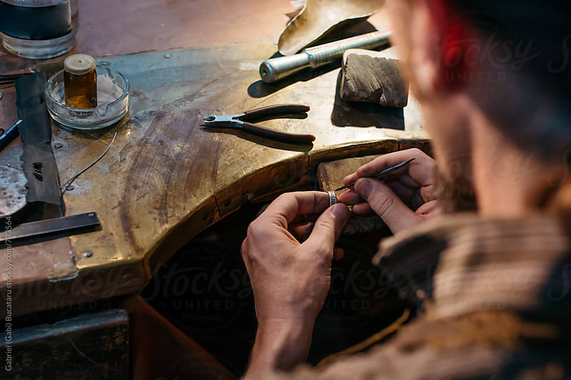 Goldsmith repairing a wedding ring by Gabriel (Gabi) Bucataru for Stocksy United