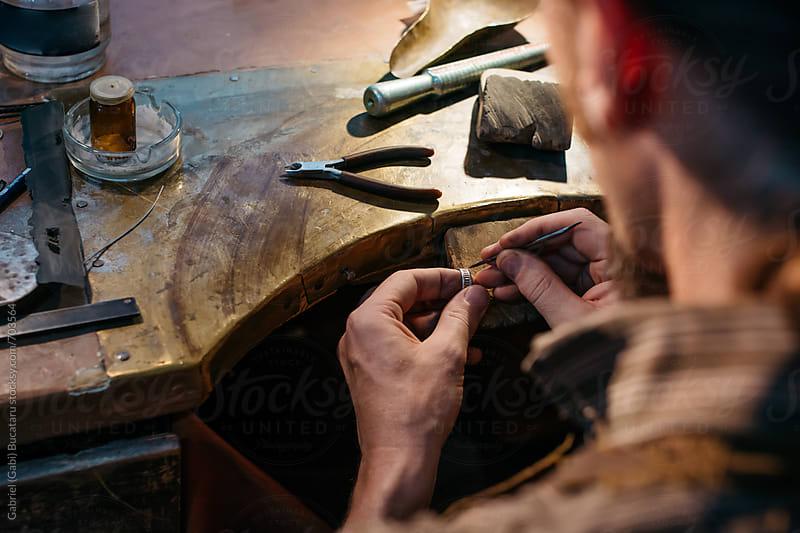 Goldsmith repairing a wedding ring by Gabriel (Gabi) Bucataru for Stocksy United