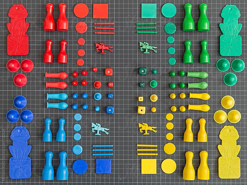 Multicolored Toys on dark background by Melanie Kintz for Stocksy United