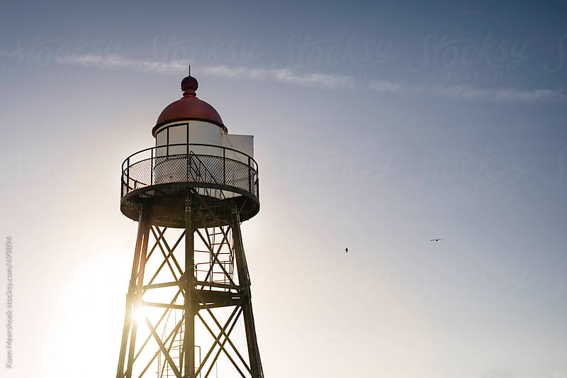 A lighthouse at the coast of Holland. by Koen Meershoek for Stocksy United