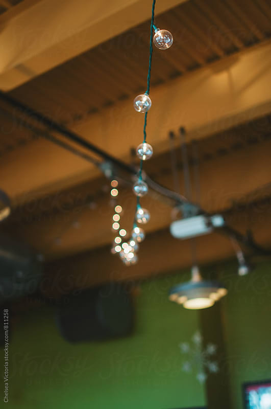 Fairy lights in a cafe by Chelsea Victoria for Stocksy United
