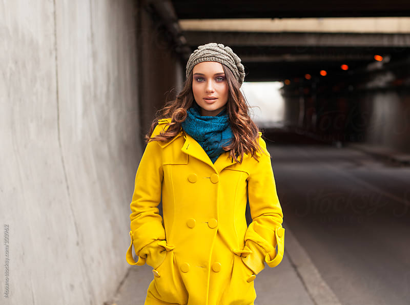 Woman in Yellow Coat Standing Near the Tunnel by Mosuno for Stocksy United