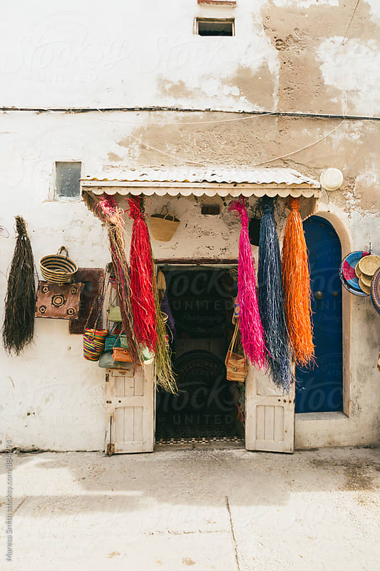 A colourful shop in a rustic Moroccan doorway by Maresa Smith for Stocksy United