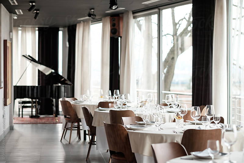 Empty Tables at the Restaurant by Brkati Krokodil for Stocksy United