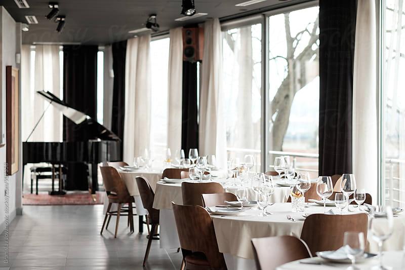 Empty Tables at the Restaurant by Branislav Jovanović for Stocksy United