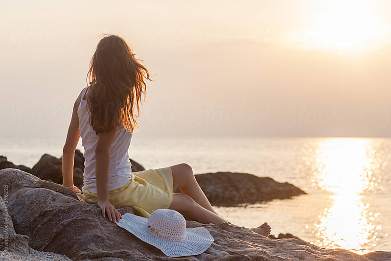Woman Enjoying Sunset at the Beach. by Mosuno for Stocksy United