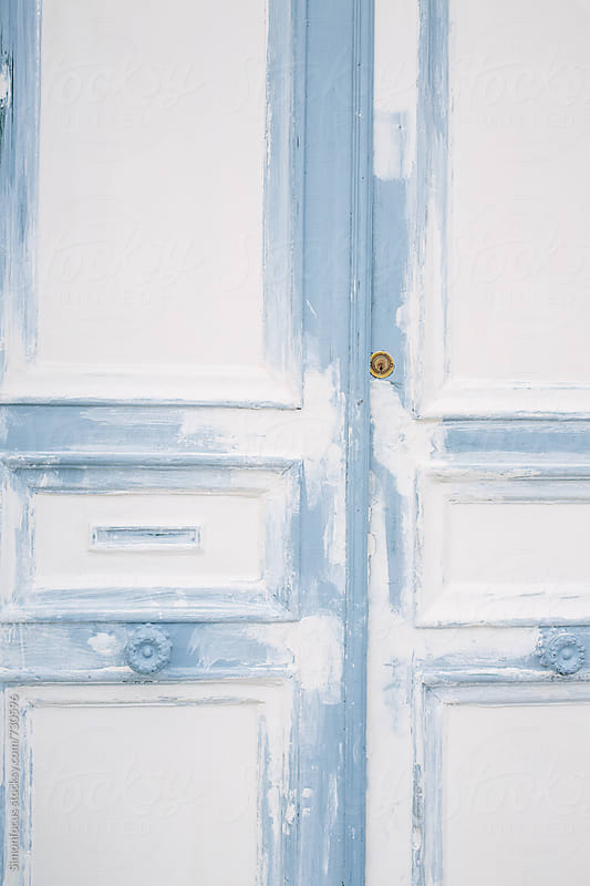 Blue and white Paris door by Simon DesRochers for Stocksy United