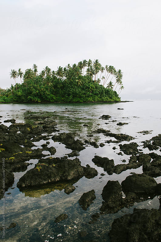 Lava, ocean and island, Samoa. by Thomas Pickard for Stocksy United
