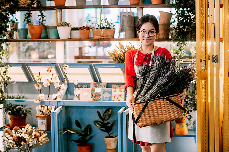 Florist Working in a Flower Shop by Lumina for Stocksy United