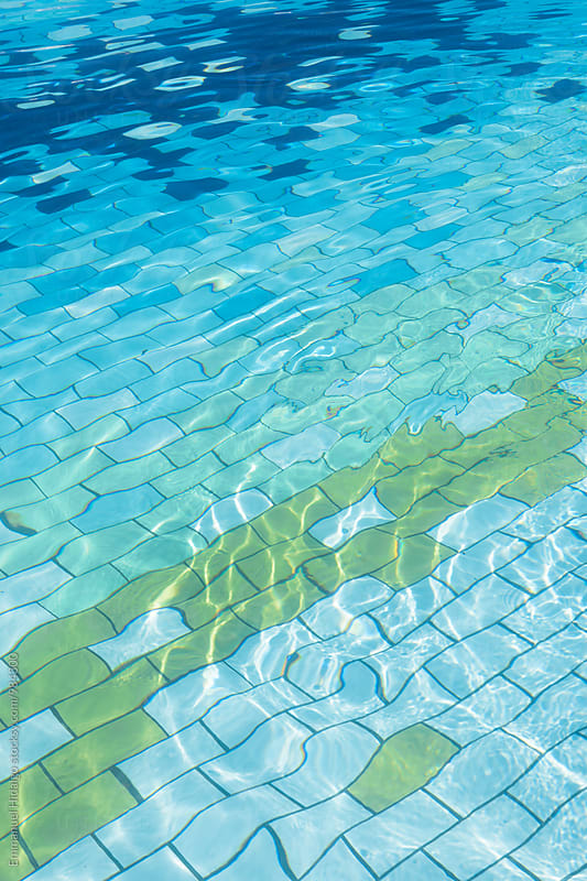 Cool tile pattern in a swimming pool in Brazil by Emmanuel Hidalgo for Stocksy United