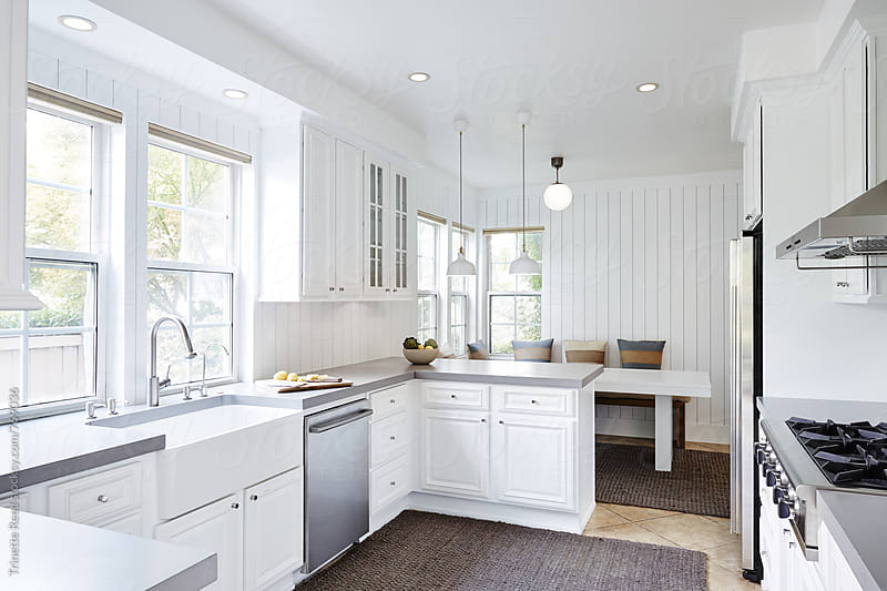 Kitchen with concrete countertops and shiplap by Trinette Reed for Stocksy United